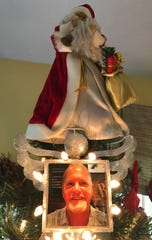 The Santa Claus Christmas tree topper at Debi Markoe's Palm Bay home features a framed photo of a smiling Tim Kendrick, her late fiancé.