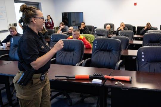 Corpus Christi Police Department Senior Officer Lillian Penick trains Rockport police in the use of less-lethal beanbag shotguns on Thursday, Dec. 12, 2019.