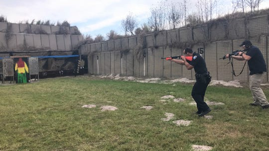 Rockport police officer Colton Garrett practices shooting less-lethal bean bag rounds at a target at the department shooting range on Thursday, Dec. 12, 2019. Detective Michael Cramer provides lethal cover to Garrett.