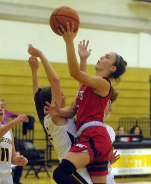 Moorestown Friends' Bella Runyan drives to the basketball in a game from last year.