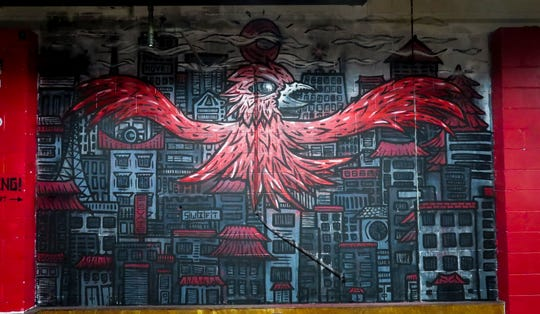 """""""Swift"""" mural at Swift Movement Studio in Winton Place was created with spray paint and acrylic paint."""