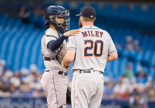 Aug 30, 2019; Toronto, Ontario, CAN; Houston Astros catcher Robinson Chirinos (28) talks with Houston Astros starting pitcher Wade Miley (20) during the second inning against the Toronto Blue Jays at Rogers Centre.