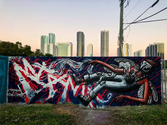 """Owen """"Tenzing"""" Gunderman collaborated with artist Danny Gamble in Miami, Florida to create this mural."""