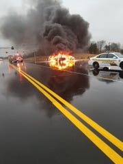 Three of four cars engulfed in flames after an accident on Warfield Boulevard, Dec. 16, 2019