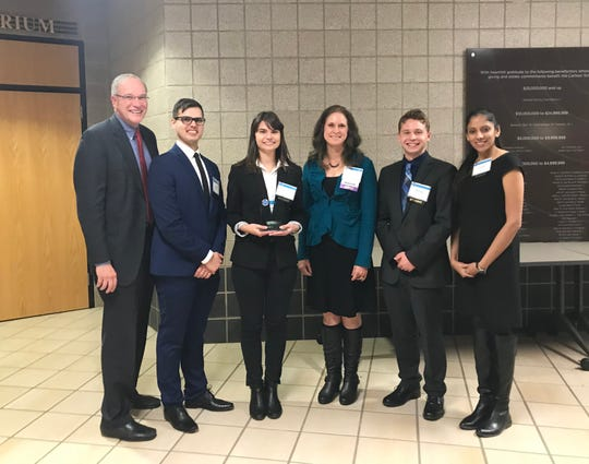 (Left to right): Faculty adviser Dave Ferio; Ben Ozdemir; Kimberly Iannarone; Peggi Tobias, Vice President of Early Careers and Onboarding, UnitedHealthcare (corporate sponsor of the competition); Nick Veronsky; and Tav Dhingra.