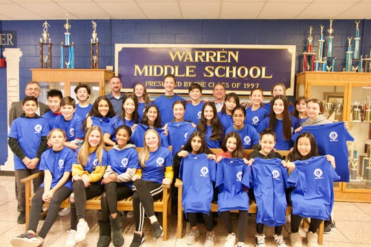 Kevin Helewa, Warren Lions Club President, Sgt. Matthew Saum and former Warren Lions Club President,  Neal Drasin are photographed with the members of LEAD Warren, after they received their brand new t-shirts courtesy of the Warren Lions Club.