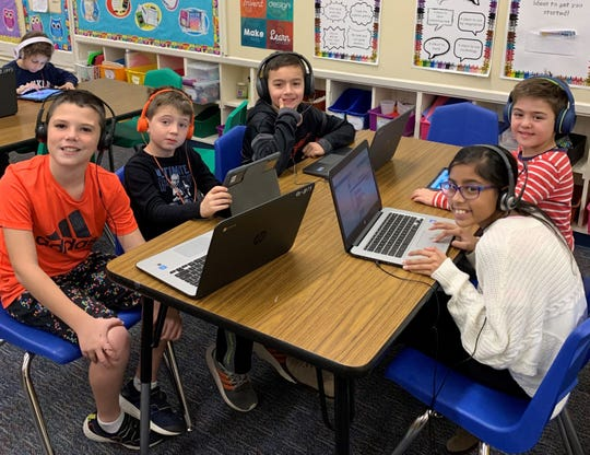 "Franklin students enjoy ""Hour of Code"" activities during Computer Science Education Week.  On left, fifth grader Adam Siegel, first grader Nicholas Paterson, and fifth grader Derin Colakoglu.  On right, fifth grader Laila Singh and first grader Atlas Pektas."