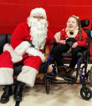 "Danielle ""Dani"" Hardesty, 10, recently visited with Santa Claus for Christmas. Dani's mother, Kala Freeman, is seeking public assistance for buying Dani a wheelchair accessible van."