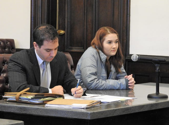 Attorney Edward Itayim with client Jessica L. Reynolds Monday in Coshocton County Common Pleas Court. Reynolds received three years of community control sanctions and 180 days in jail for her role in an April home invasion and assault which led to a charge of burglary.