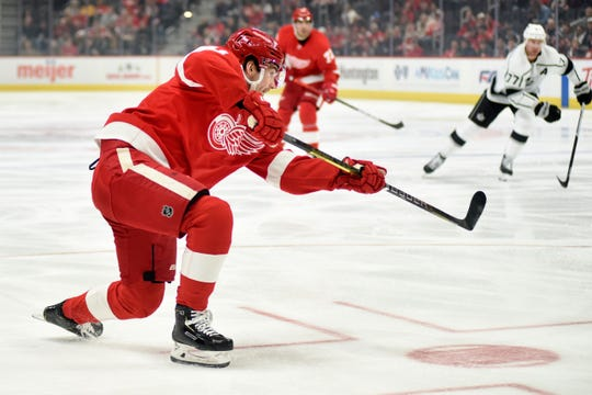 Detroit Red Wings right wing Filip Zadina shoots in the first period against the Las Angeles Kings, Sunday, Dec. 15, 2019, in Detroit.