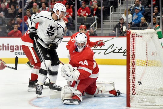 Los Angeles Kings center Anze Kopitar scores past Detroit Red Wings goaltender Eric Comrie in the second period Sunday, Dec. 15, 2019, in Detroit.