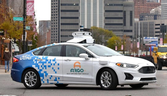 Argo AI drivers test one of their self-driving Ford Fusions in Detroit's Corktown neighborhood. The technology company is a partner with Ford and Volkswagen.