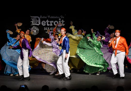 Advanced dancers dressed in apparel of the Mexican state of Nayarit perform El Jarabe Nayarita during the Ballet Folklorico De Detroit 6th Annual Holiday Concert at the Senate Theater in Detroit on Dec. 15, 2019.