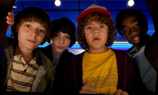 "Noah Schnapp, left, Finn Wolfhard, Gaten Matarazzo and Caleb McLaughlin in a scene from ""Stranger Things"" from Netflix."