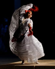 Soloist Vanessa Galaviz performs La Morena celebrating the Mexican state of Veracruz during the Ballet Folklorico De Detroit 6th Annual Holiday Concert at the Senate Theater in Detroit on Dec. 15, 2019.