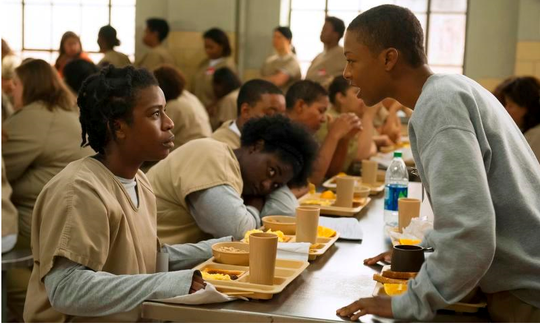 "Uzo Aduba, left, and Samira Wiley in ""Orange is the New Black."" In less than a decade, Netflix went from about 12 million U.S. subscribers at the decade's start to 60 million this year."