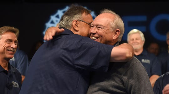 Fiat Chrysler CEO Sergio Marchionne, left, and UAW President Dennis Williams  embraced  at the start of contract talks in 2015. GM charges that Marchionne orchestrated a bribery conspiracy to corrupt three rounds of bargaining with the UAW in an effort to harm and take over Detroit's biggest automaker.