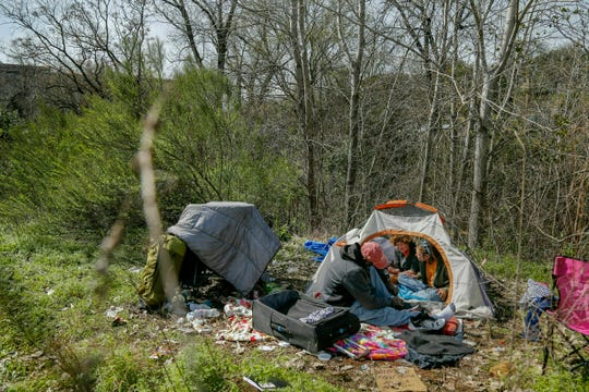 In this Wednesday, Feb. 13, 2019 file photo, people have lunch at their camp in south Austin, Texas.