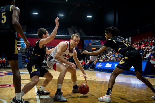 USI's Glen Rouch (23) just before he loses control of the ball at the USI vs. Lincoln game at the Screaming Eagles Arena in Evansville, Sunday, Dec. 15, 2019.