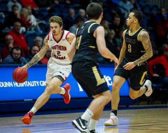 USI's Clayton Hughes (2) moves past Lincoln's defense at the USI vs. Lincoln game at the Screaming Eagles Arena in Evansville, Sunday, Dec. 15, 2019.