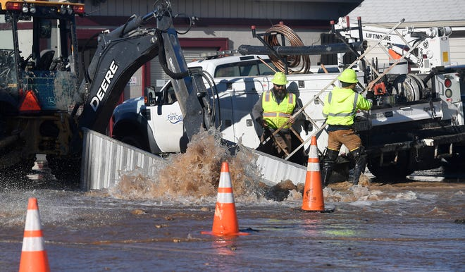 Crews from Fort Collins Utilities work on a water main break along Jefferson Street in Old Town on Monday, Dec. 16, 2019. Local governments, including the city, Larimer County and CSU, added 6,100 new jobs to the region in the past five years.