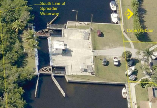 Aerial view of Chiquita Lock in Cape Harbour, Cape Coral. An adminstrative judge has recommended that a permit to tear down the locks be denied.