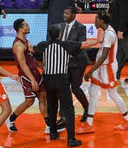 South Carolina guard Jair Bolden(52), left, and Clemson guard Tevin Mack(13) are separated after the 67-54 Gamecock win at Littlejohn Coliseum Sunday, December 15, 2019.