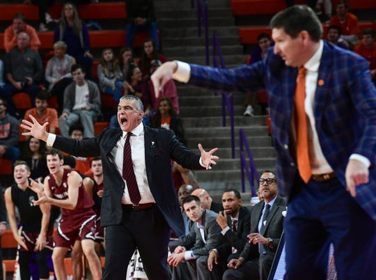 South Carolina Head Coach Frank Martin and Clemson Head Coach Brad Brownell communicate with their own players during the second half at Littlejohn Coliseum Sunday, December 15, 2019.
