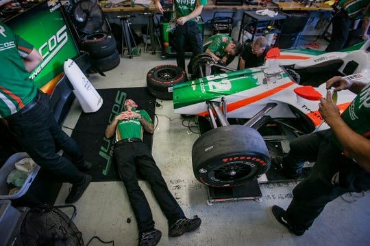 "Rich Jones, the crew chief of Juncos Racing, lays on the floor of the garage, Saturday, May 18, 2019, at the Indianapolis Motor Speedway. The team rebuilt the car overnight to help Kyle Kaiser qualify for the Indianapolis 500. ""We built a completely new car. There is not a lot left of the car that we ran, it was a great car that we had,"" said Jones. ""It was super fast, super consistent all week, then we got rid of that one, and built this."""