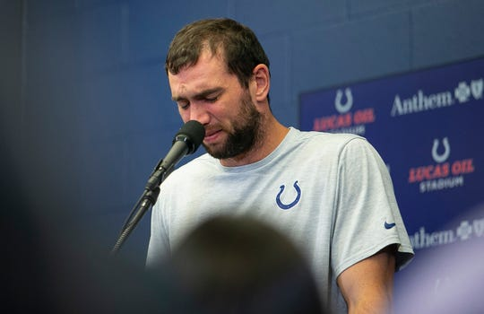 Andrew Luck breaks down into tears during a press conference announcing his retirement.