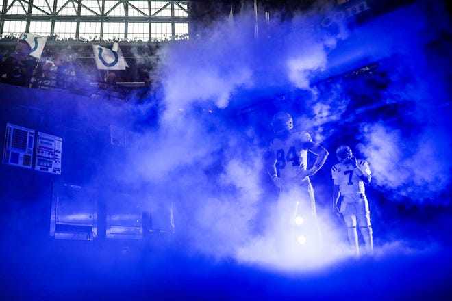 Indianapolis Colts tight end Jack Doyle (84) and quarterback Jacoby Brissett (7) get ready to run onto the field before their game against the Tennessee Titans at Lucas Oil Stadium on Sunday, Dec. 1, 2019.