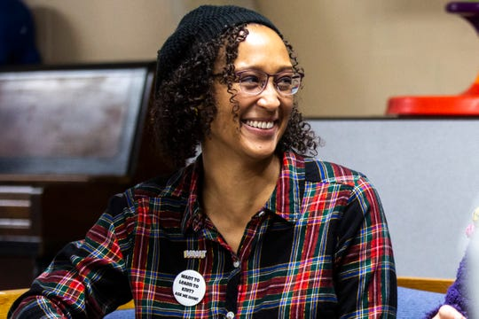 Angie Jordan, member of the South District Neighborhood Association, smiles during a Banjo Knits weekly knitting circle Dec. 14 at the Broadway Neighborhood Center in Iowa City.