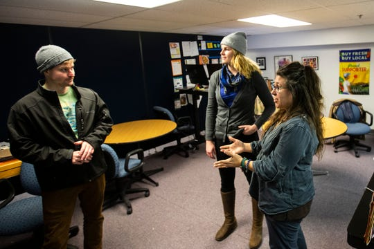 Michelle Kenyon, far right, talks with Bryan Bjorkland, left, and Giselle Bruskewitz, Thursday, Dec. 12, 2019, at the Field to Family Food Hub on South Capitol Street in Iowa City, Iowa.