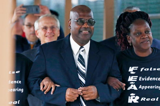 Curtis Flowers flanked by sister Priscilla Ward, right, exits the Winston Choctaw Regional Correctional Facility in Louisville, Miss., Monday, Dec. 16, 2019. Flowers' murder conviction was overturned by the U.S. Supreme Court for racial bias, and he was granted bond by a circuit judge and is free, with some conditions, for the first time in 22 years.