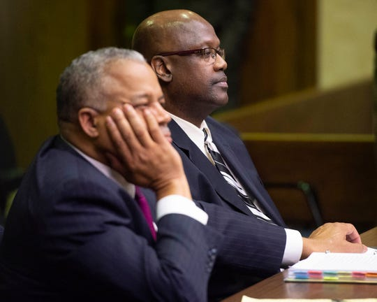 Curtis Flowers, right, sits with his counsel, Henderson Hill from North Carolina, during the bond hearing at Montgomery County Courthouse in Winona, Miss., on Monday, Dec. 16, 2019.