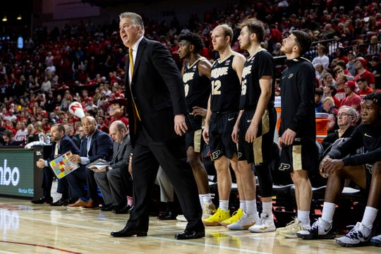 Purdue head coach Matt Painter, left,  instructs his players on the court against Nebraska during the second half of an NCAA college basketball game in Lincoln, Neb., Sunday, Dec. 15, 2019. (AP Photo/John Peterson)