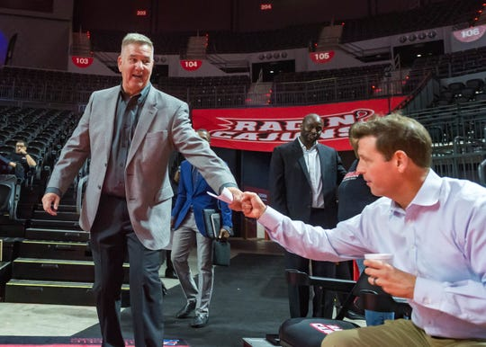 UL women's basketball coach Garry Brodhead bumps fists with athletic director Bryan Maggard during a game against Mississippi State this season.