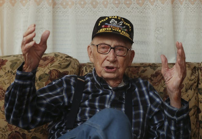 Curtis B. Hall, 95, describes an explosion from German artillery that he says lifted the earth in front of him during the Battle of the Bulge. Hall was sharing his experience serving in the U.S. Army on several intelligence and reconnaissance missions during the World War II battle. [Karen Schiely/Beacon Journal]