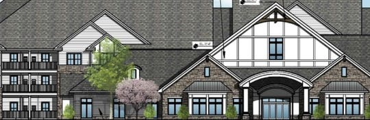 A detail of an architectural rendering shows what a 146-unit senior living facility proposed in Hartland Township would look like.