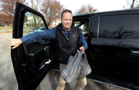 Pete Thieneman arrives at a location to deliver food for the Meals on Wheels program. Dec. 12, 2019