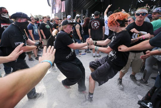 The crowd formed a mosh pit during the performance of Sick Puppies at the Louder Than Life Festival on Sept. 29, 2019 in Louisville, Kentucky.