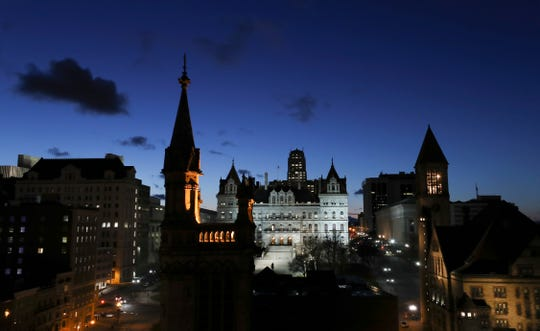 A late evening view of the the New York State Capitol building in Albany, New York.   March 31, 2019