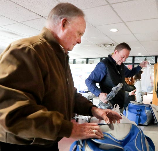 Pete Thieneman and his father pack up the meals they will deliver today as part of the Meals on Wheels program. Dec. 12, 2019