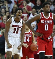 Louisville's Steven Enoch (23) celebrates a forced turnover as NC State's D.J. Funderburk (0) felt the pressure during the Cardinals 84-77 victory at the KFC Yum Center. Jan. 24, 2019