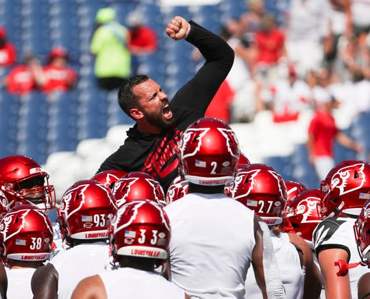 University of Louisville gets pumped up by quality control coach Nic Cardwell before their game against WKU at Nissan Stadium in Nashville. Sept. 14, 2019