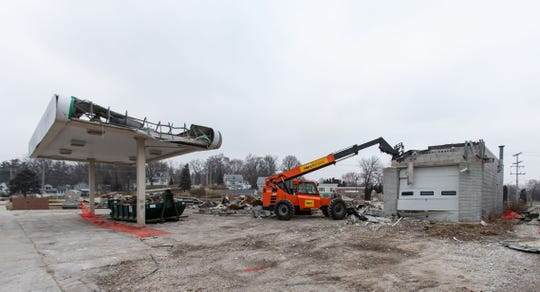 Demolition of the former Denny's Service BP gas station in Pewaukee is nearly complete as seen on Saturday, Dec. 14, 2019.