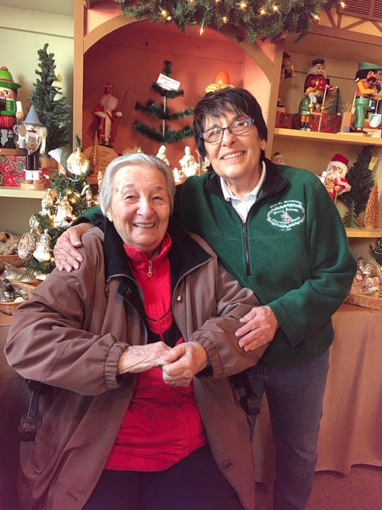 Irene Blau (left) and her daughter, Joanie Morrissey are celebrating 31 years  at Germantown's Sinter Klausen Christmas Markt. The shop will close Dec. 29.