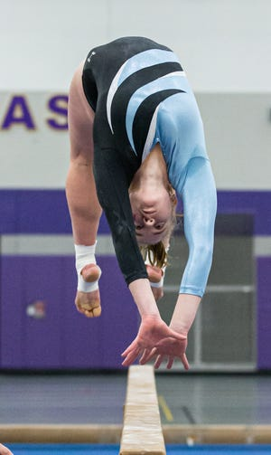 Arrowhead's Lily Stemper competes on the beam during the 2019 Cooney Gymnastics Invitational at Oconomowoc on Saturday, Dec. 14.