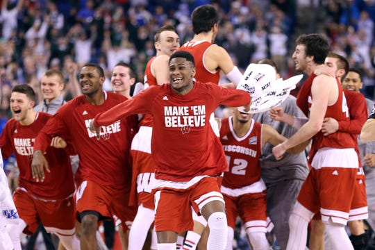 The Wisconsin Badgers celebrate after defeating the Kentucky Wildcats during the NCAA Men's Final Four Semifinal at Lucas Oil Stadium on April 4, 2015 in Indianapolis, Indiana.