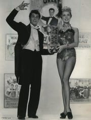 """Tony Curtis, left, and Janet Leigh star as master illusionist Harry Houdini and his wife Bess in the 1953 movie """"Houdini,"""" this year's Christmas Cinema selection at Jewish Museum Milwaukee Dec. 25."""
